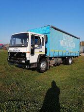VOLVO FL618 camión toldo