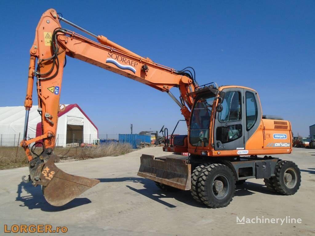 DOOSAN DX 140 W excavadora de ruedas